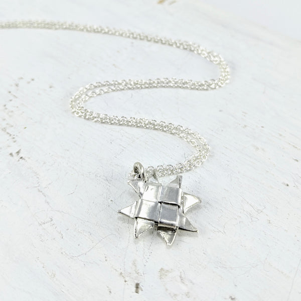 Handmade in New Zealand by Keri-Mei Zargrobelna. Silver woven star on a silver chain.