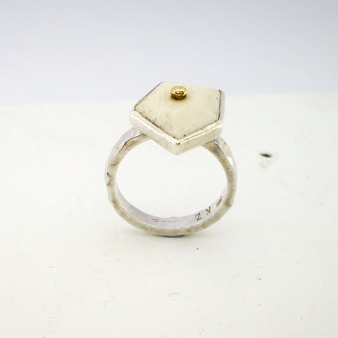 This handmade silver ring by Keri-Mei Zagrobelna is set with a faceted irregular piece of white beef bone, and topped with a small gold ball.