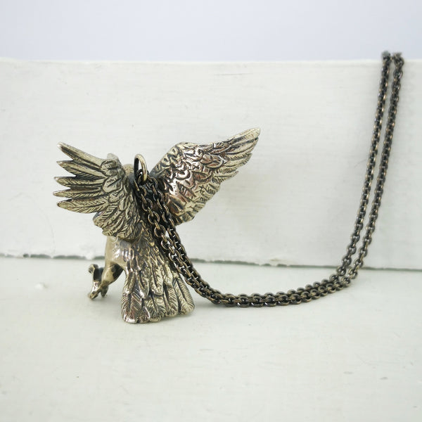 Kea pendant by The Wild Jewellery. Soldi sterling silver, the Kea has wings out and is poised to land. On a sterling silver chain.