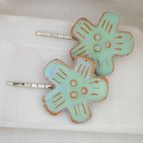 Two handmade ceramic hair clips by NZ jeweller Marita Green. Mint Green ceramic flowers on metal hair slides.