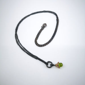 Peridot Bell Necklace in Oxidised Silver by Natalie Salisbury