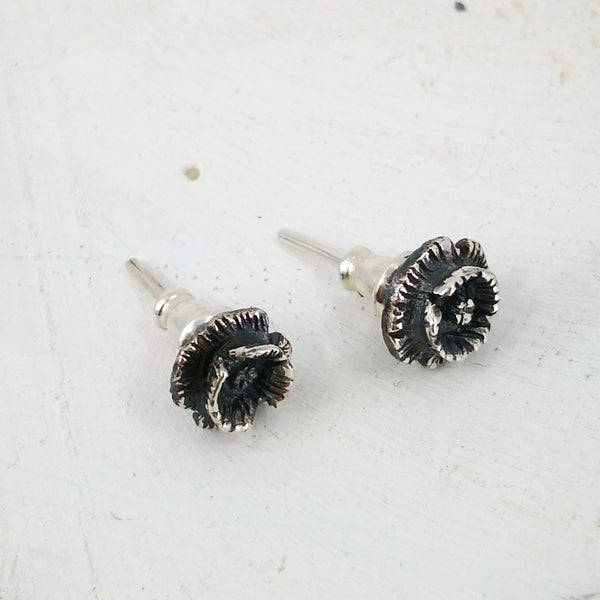 Tiny Poppy Studs in sterling silver. Hand-crafted by Rebecca Fargher.
