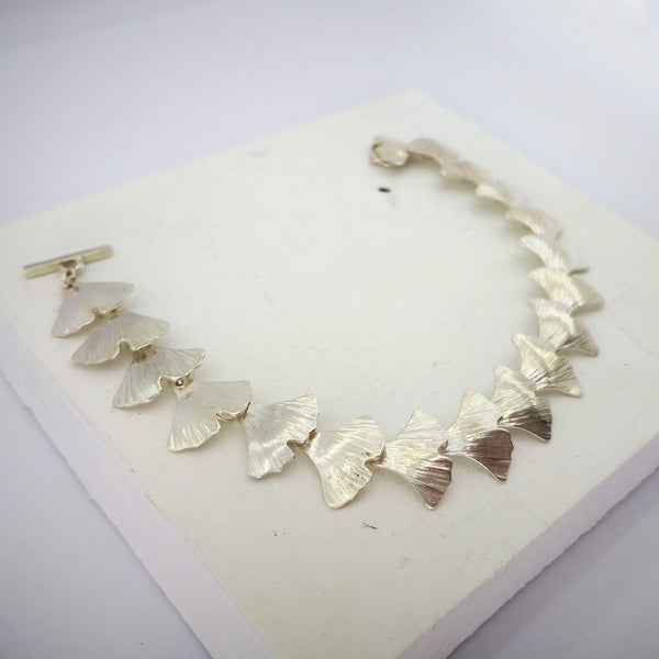 Ginkgo Leaf bracelet by Ruru Jewellery. Each silver Ginkgo leaf is individually hand formed.