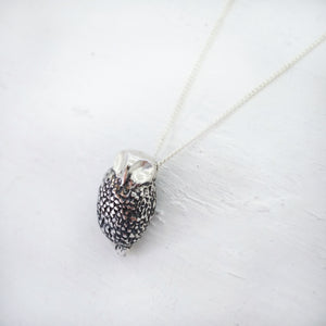 Ruru pendant in solid sterling silver on a sterling silver chain. Handmade by Ruru Jewellery.