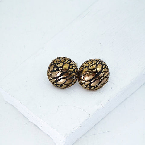 Tuatara Studs in solid bronze. Round domed textured scales hand made by The Wild Jewellery.