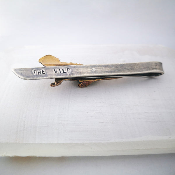 "The back of the tuatara tie slide showing the stamped ""The Wild"" text. Hand crafted in silver and bronze by The Wild Jewellery."