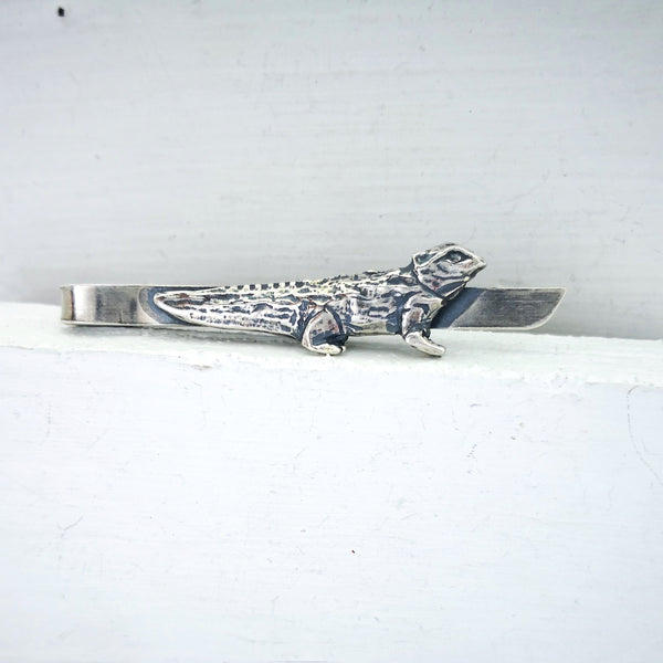Tuatara tie slide in solid antiqued silver. Hand crafted by The Wild Jewellery.