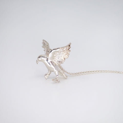 Kea pendant by The Wild Jewellery. Soldi sterling silver pendant and chain. Kea has wings out poised to land.
