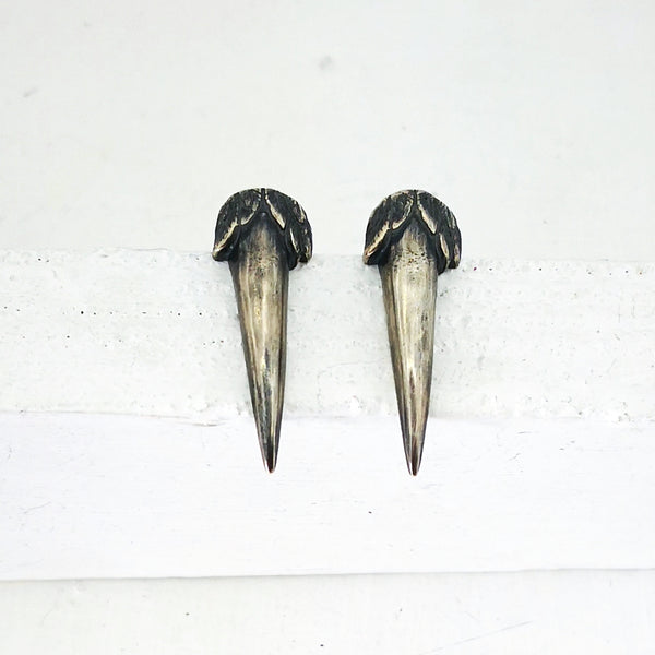 These hand crafted sterling silver studs are in the shape of a bird's claw with tiny feathers around the top. Inspired by the Native Owl - the Ruru. By The Wild.