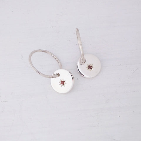 Starry Night Sleepers by Zoë Porter Jewellery.  Tiny faceted garnets star set into sterling silver discs.