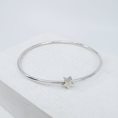 Star bangle in silver by Zoë  Porter. Hand crafted in NZ.