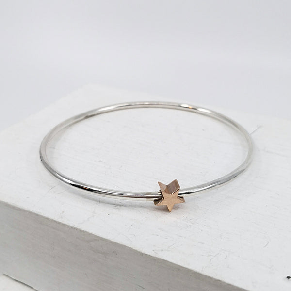 Star bangle in silver and gold by Zoë  Porter. Hand crafted in NZ.