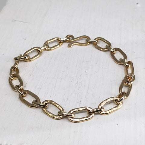 This solid 9ct gold chain bracelet is entirely hand crafted by Zoë  Porter.