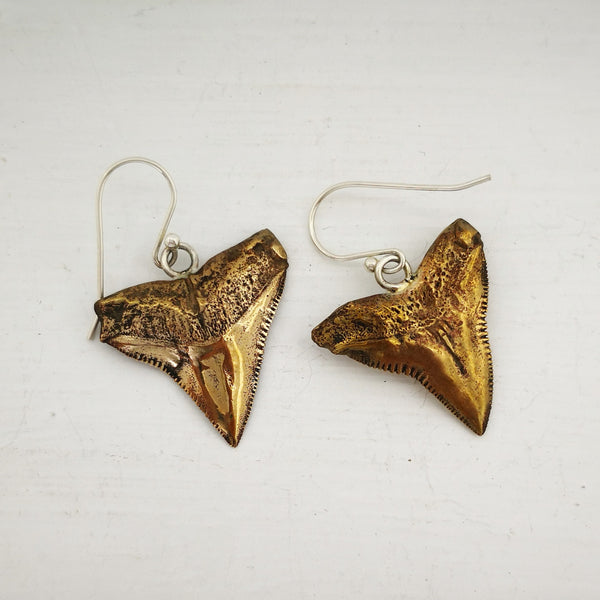 This photo shows the front and the back of the bronze shark teeth earrings. By Keri-Mei Zagrobelna