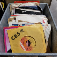 Stack of Vintage 45 RPM Records