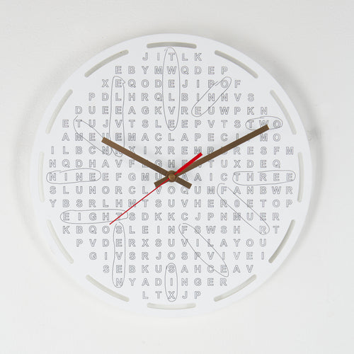 Crossword clock from Scotch & Sofa with the hour signs circled like on a crossword puzzle.