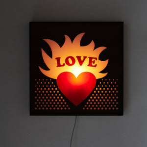 Mounted Love Sign Light litten up with no room lights on.