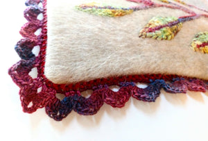 Close up image of completed optional crochet trim around pillow cover