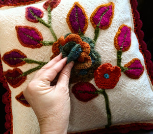 Close up of hand crocheted three dimensional floral appliques