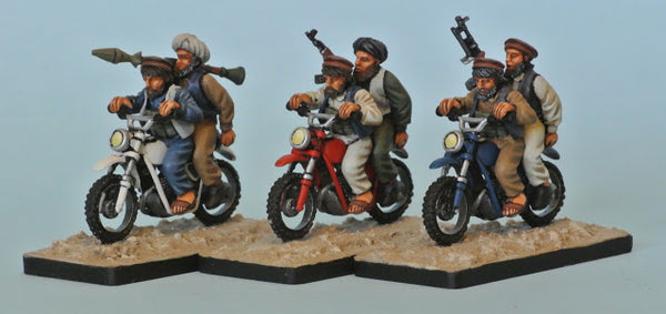 (100MOD087c) NEW Afghans on motorbike with RPG
