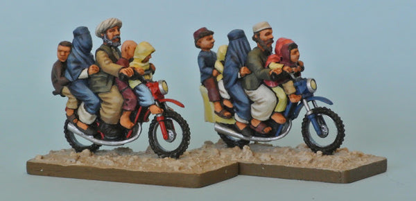 (100MOD087f) NEW Afghan family on motor bike (6 people)