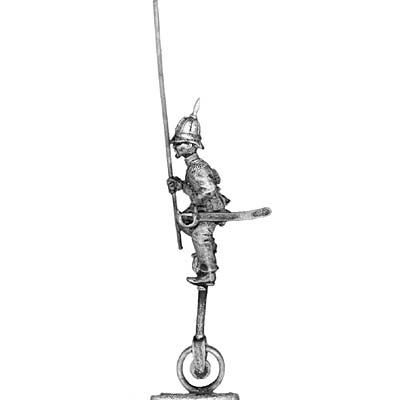 (PAXR03) Standard Bearer on unicycle in pith helmet