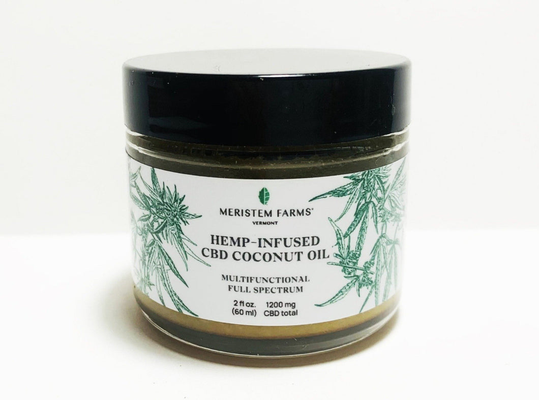 glass jar with white label includes green botanical drawings of hemp or cannabis plants with label text in black along with company logo.  Jar lid is black.  Photo is on a white background.