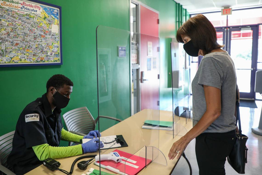 Miami Dade College students and staff get the temperature checked when they arrive to the Homestead campus check point on June 17, 2020. Miami Dade College