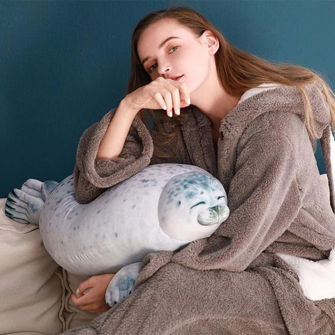 Cute Seal Stuffed Being Held by Woman