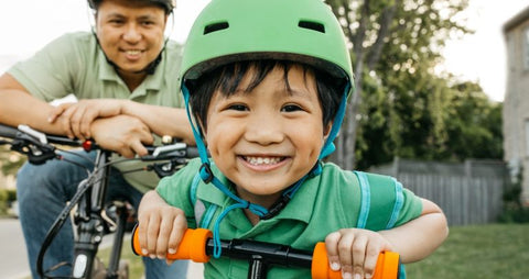 Kids Wearing a Safety Helmet on a Bike