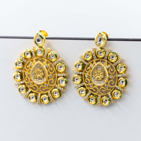 Gold Kundan earrings.