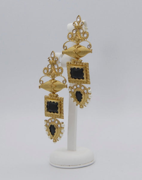 Quirky high gold earrings