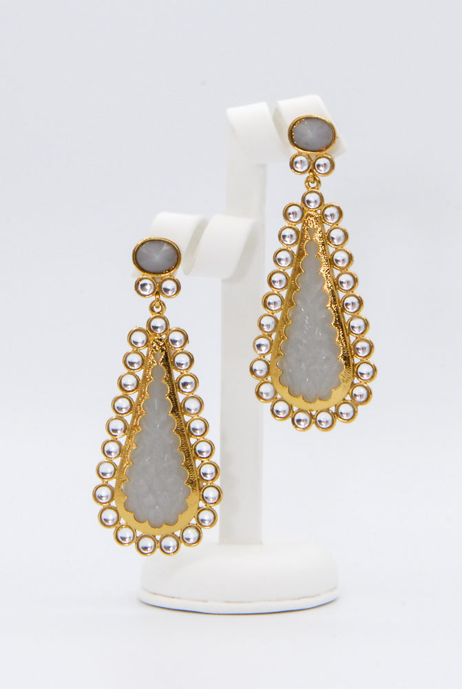 Gray teardrop shaped earrings.