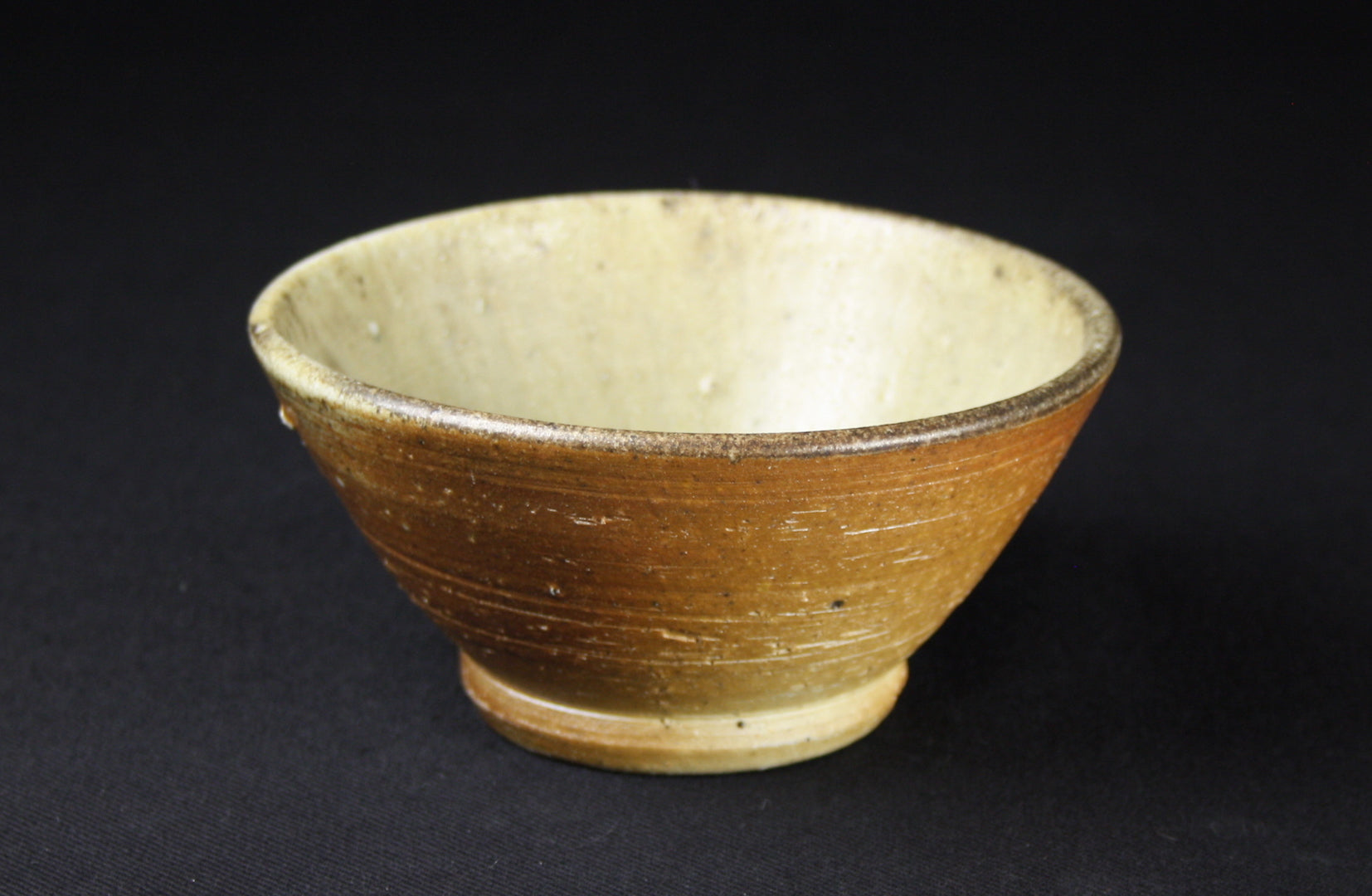 Small bowls, turned foot, 6cm high, 13cm dia., ash celadon glaze, natural flashing
