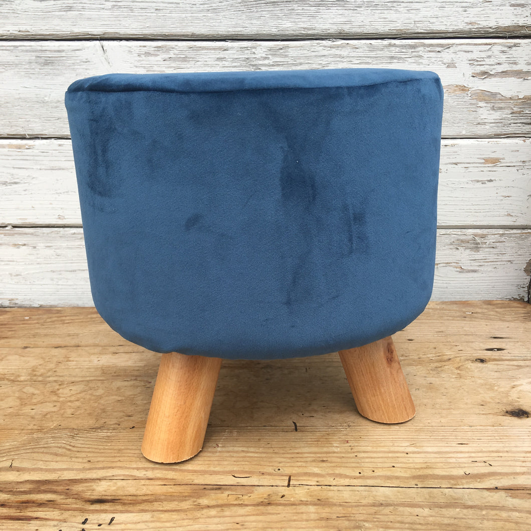 Small velvet footstool in navy