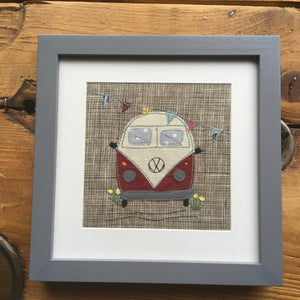 Framed red VW camper van with bunting