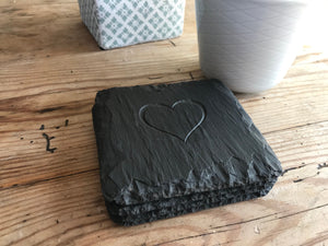 Set of Welsh slate coasters engraved with a heart