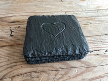 Load image into Gallery viewer, Welsh slate coasters with natural finished edge and engraved in the centre with a heart