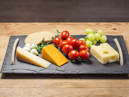 Welsh slate cheese board with jute rope handles knotted underneath to create feet
