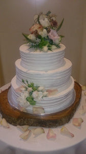 Frosted 3 tier wedding cake