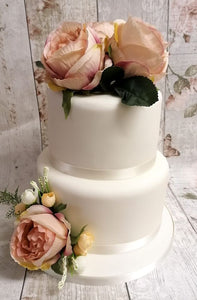 Budget wedding cake with silk flowers