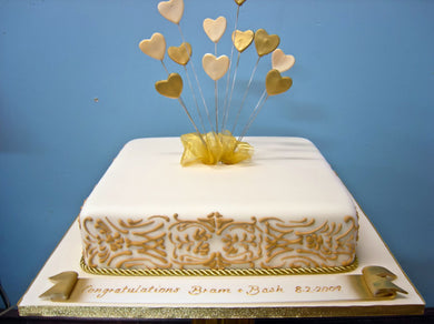 Piped border and heart explosion cake