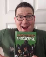 Photo of Greg Smith Holding Vol. 1 Junior Braves of the Apoclypse