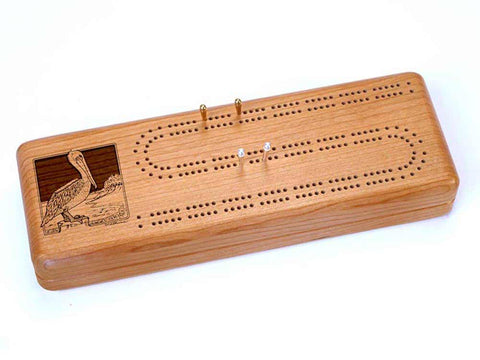 Top View of a Continuous Cribbage Board w/ Cards with laser engraved image of Brown Pelican