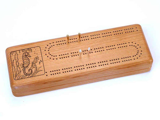 Top View of a Continuous Cribbage Board w/ Cards with laser engraved image of Sea Horse
