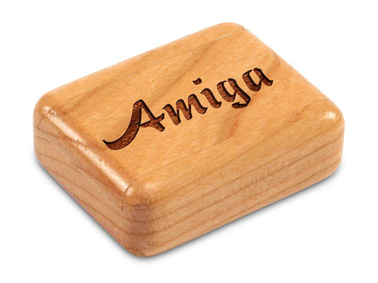 "Top View of a 2"" Flat Narrow Cherry with laser engraved image of Amiga"