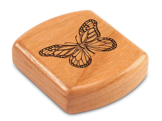 "Top View of a 2"" Flat Wide Cherry with laser engraved image of Butterfly"