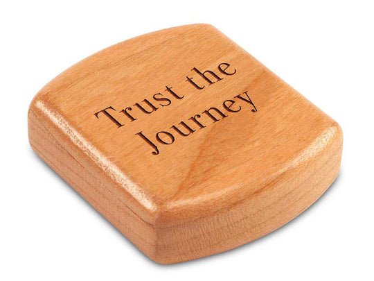 "Top View of a 2"" Flat Wide Cherry with laser engraved image of Quote -Trust the Journey"