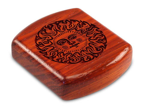 "Top View of a 2"" Flat Wide Padauk with laser engraved image of Smiling Sun"
