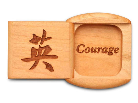"Top View of a 2"" Flat Wide Cherry with laser engraved image of Courage"